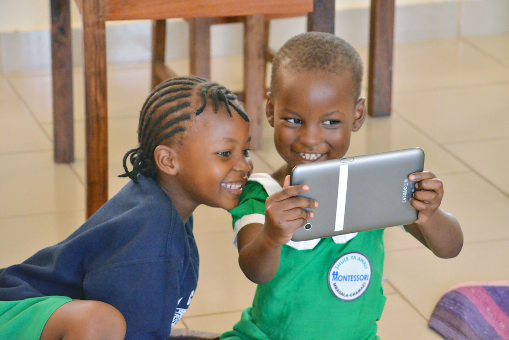 Photo of two kids using SMILE on a tablet