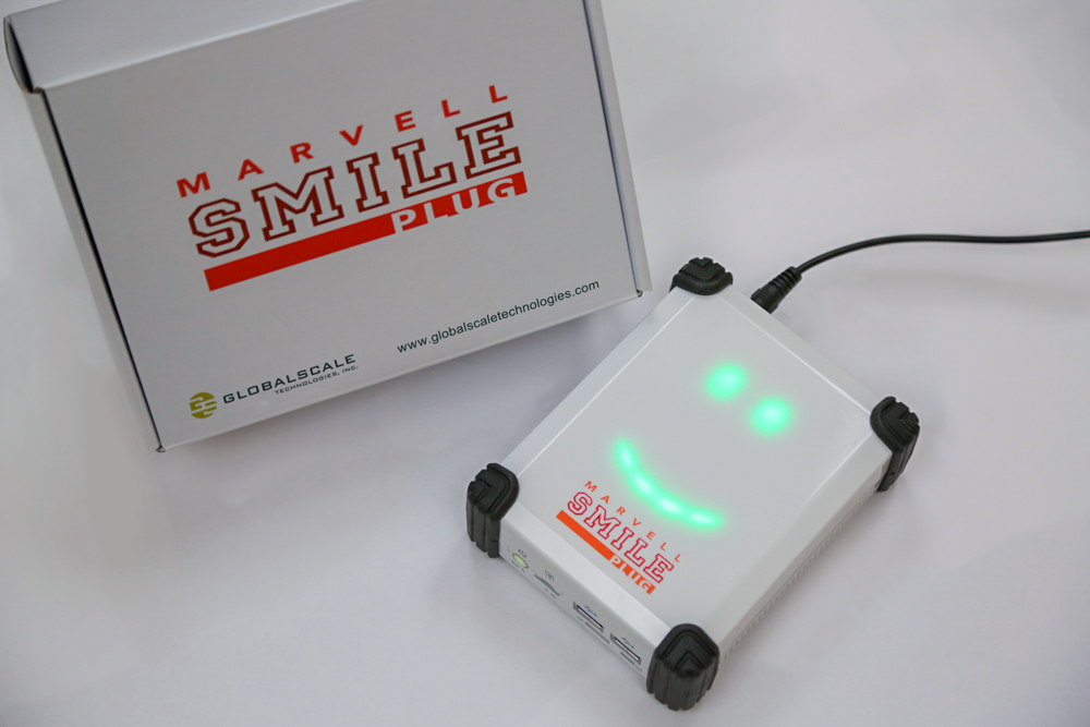 Photo of a SMILE plug (white box with SMILE logo)
