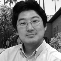 Black and white headshot of Paul Kim