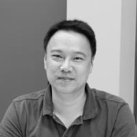 Black and white headshot of Steven Hu